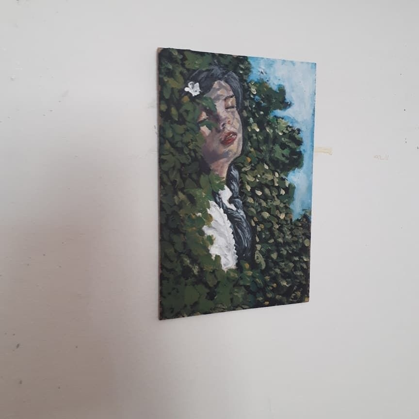 Small acrylic painting on piece of wood.