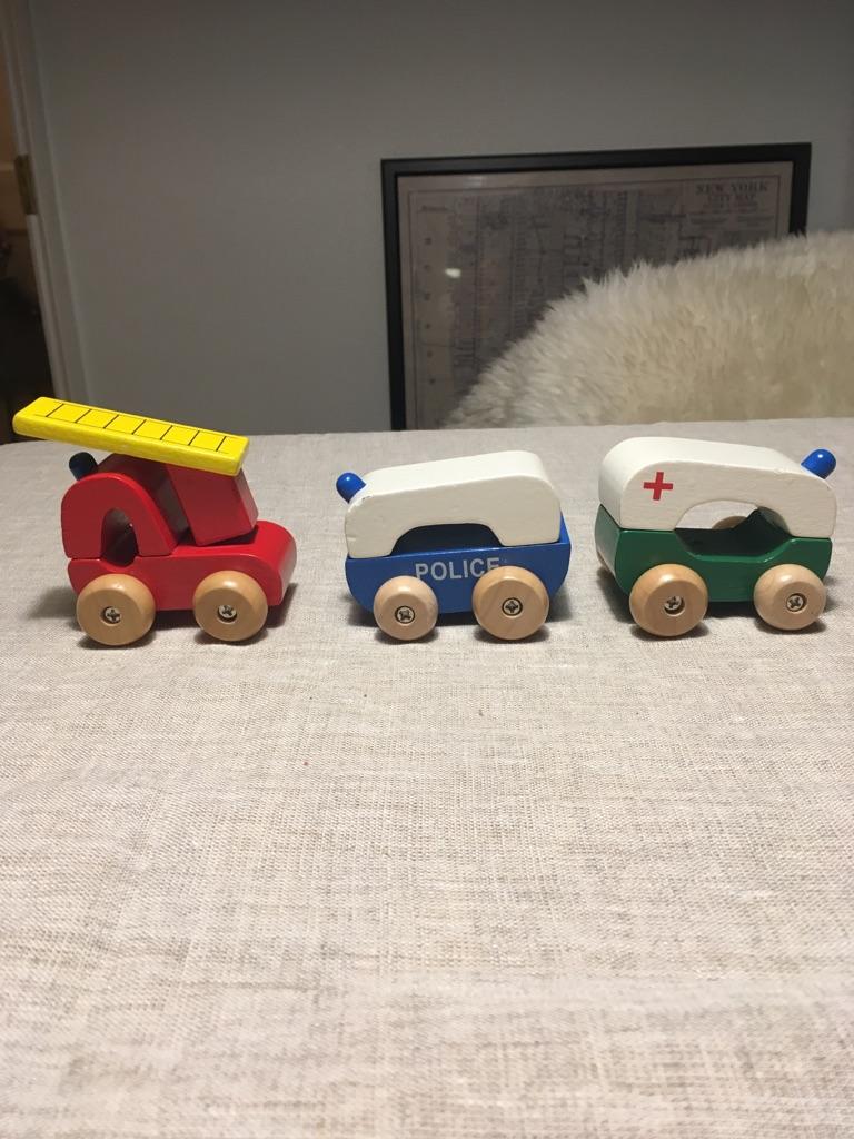 Three wooden emergency vehicles