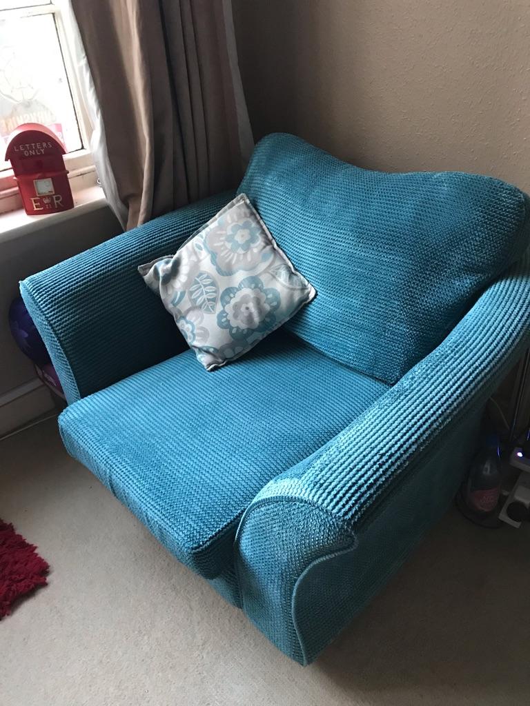 DFS Armchair. Cuddle style. Good condition. Teal colour