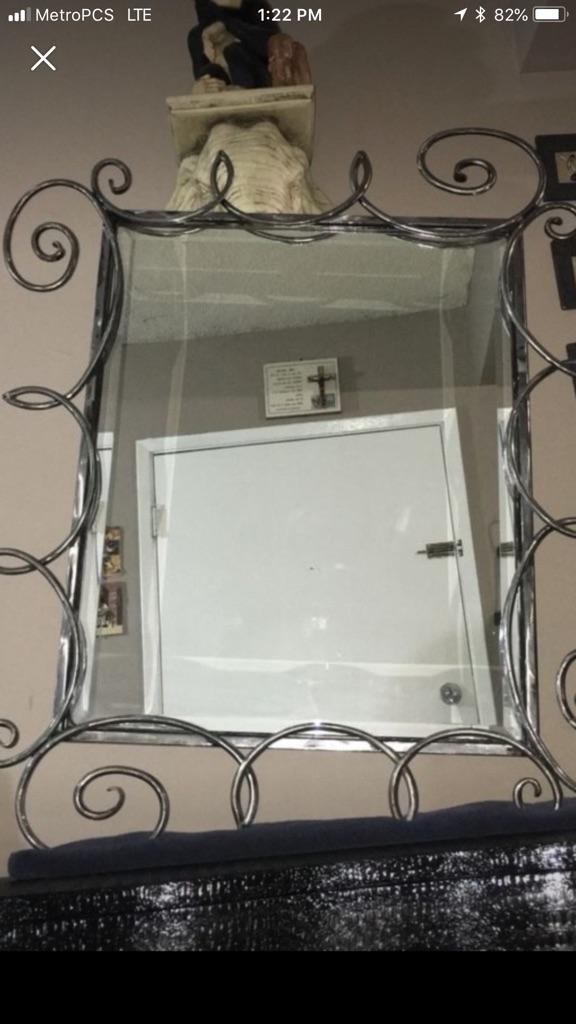 Modern metal swirl looking mirror