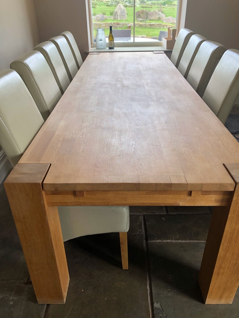 Solid Oak Table and 10 faux cream leather chairs