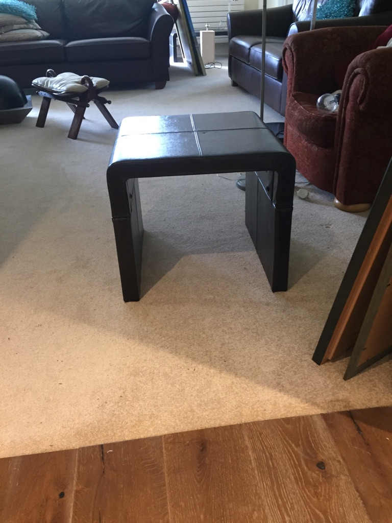 Two matching dark brown leather coffee tables