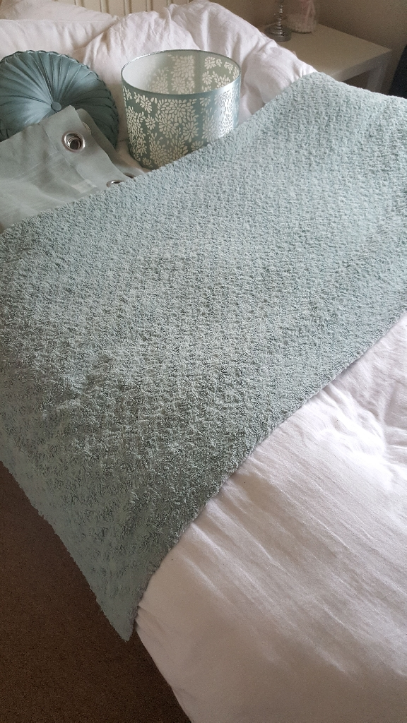 Pale green throw
