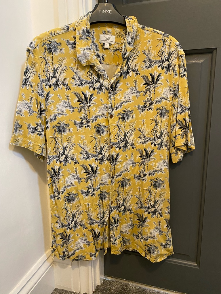 Floral yellow casual shirt.