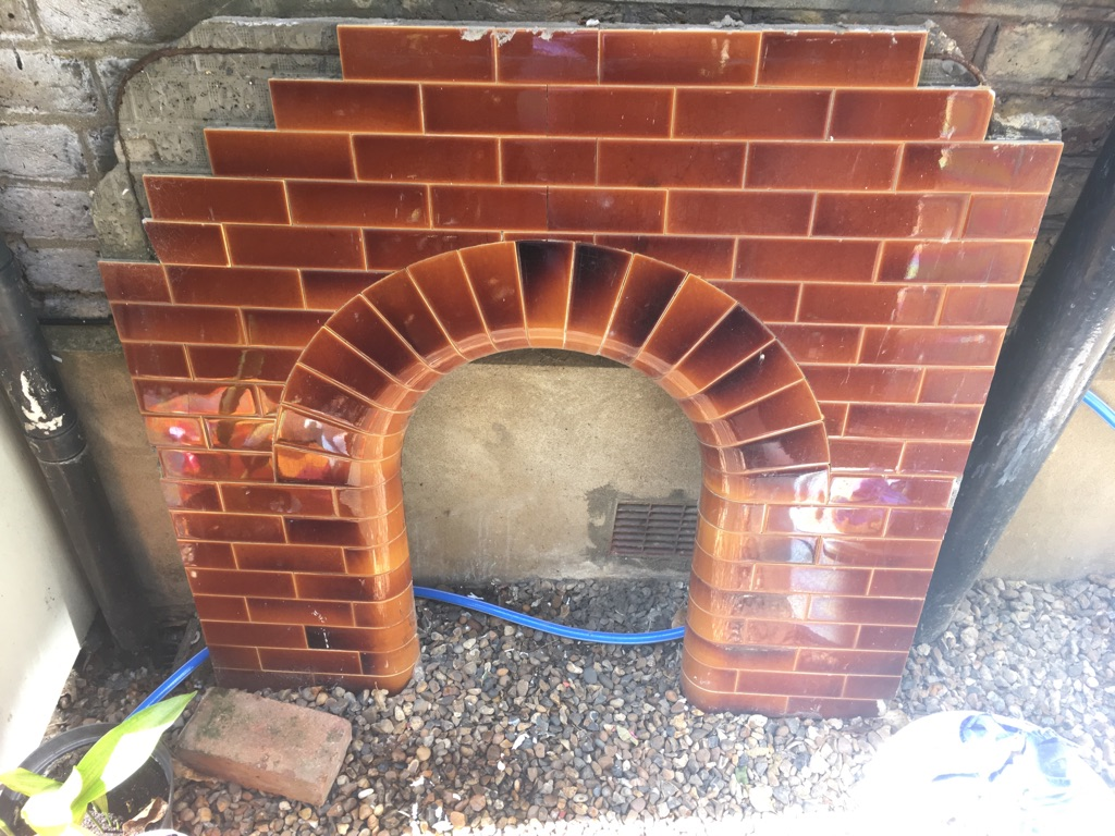 FREE - tiles fireplace insert with some tiles missing
