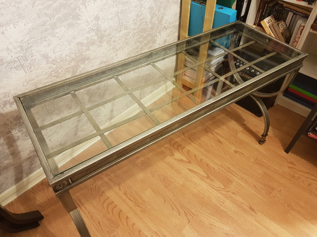 Metal table with a glass top