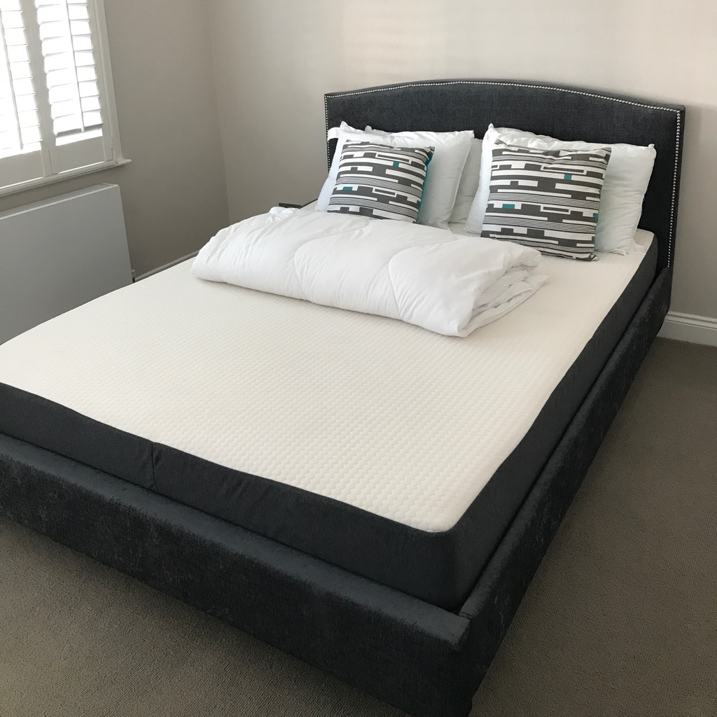 Dark grey velvet king size bed and mattress.