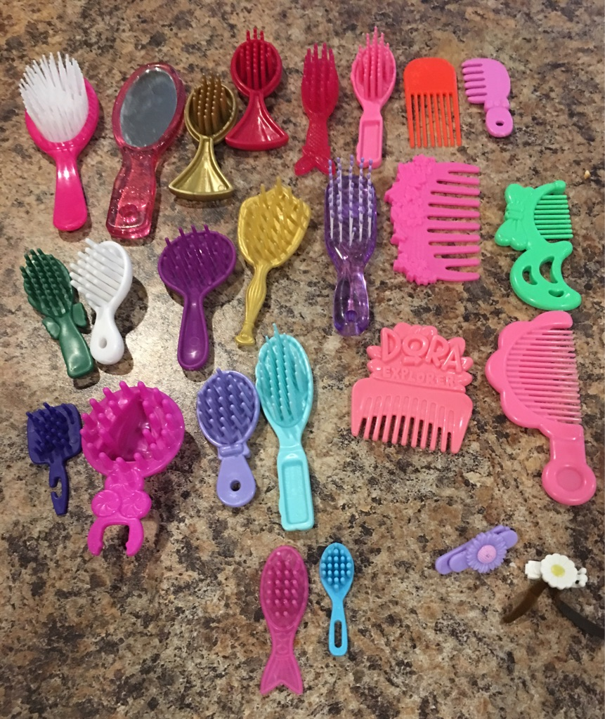 Doll's hair brushes and combs