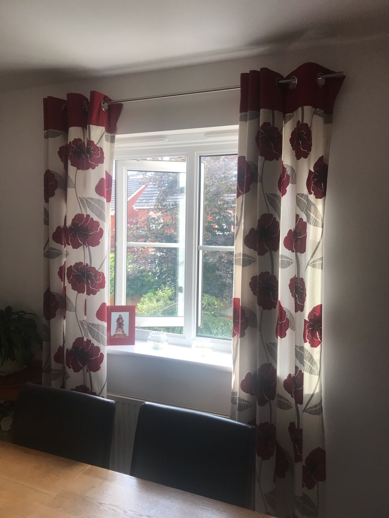 Red and white poppy curtains and pole