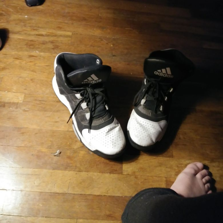 Adidas black and white high top basketball shoes.