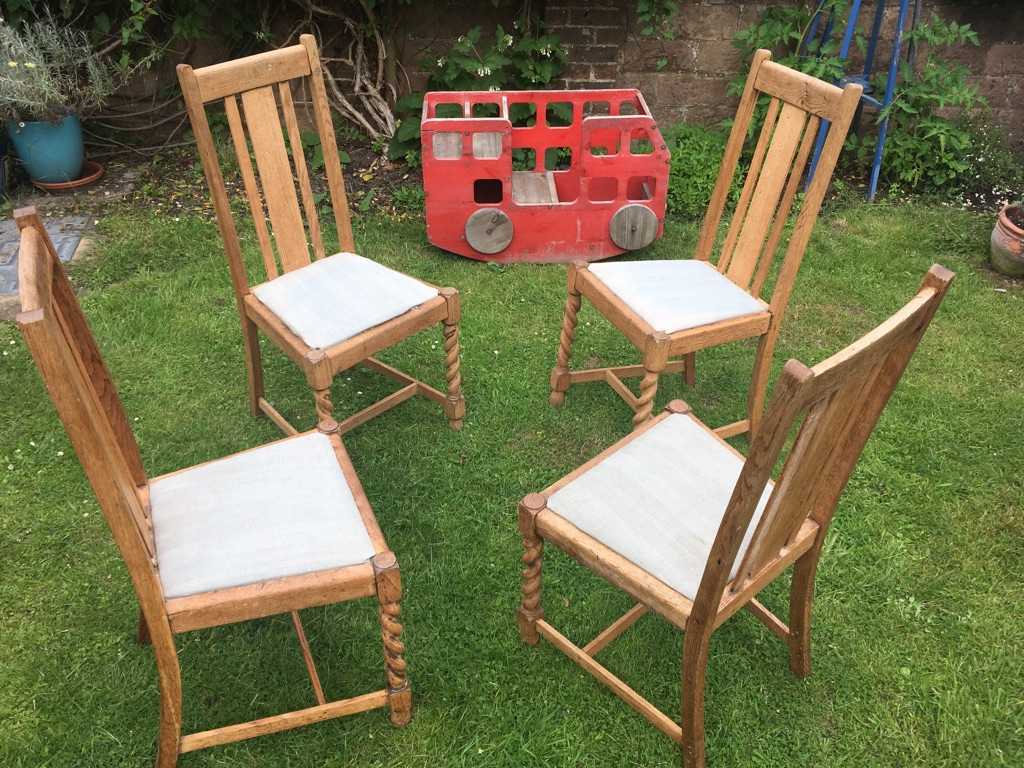 Four solid oak dining room chairs