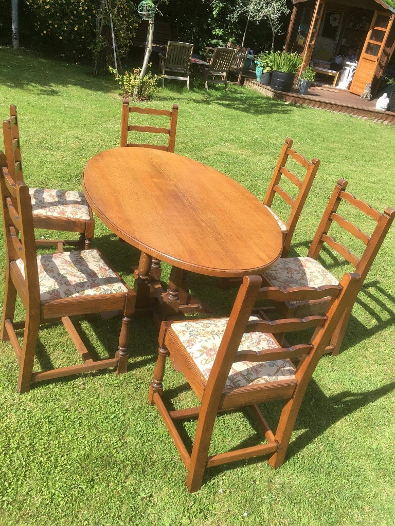 Oak take and tapestry chairs