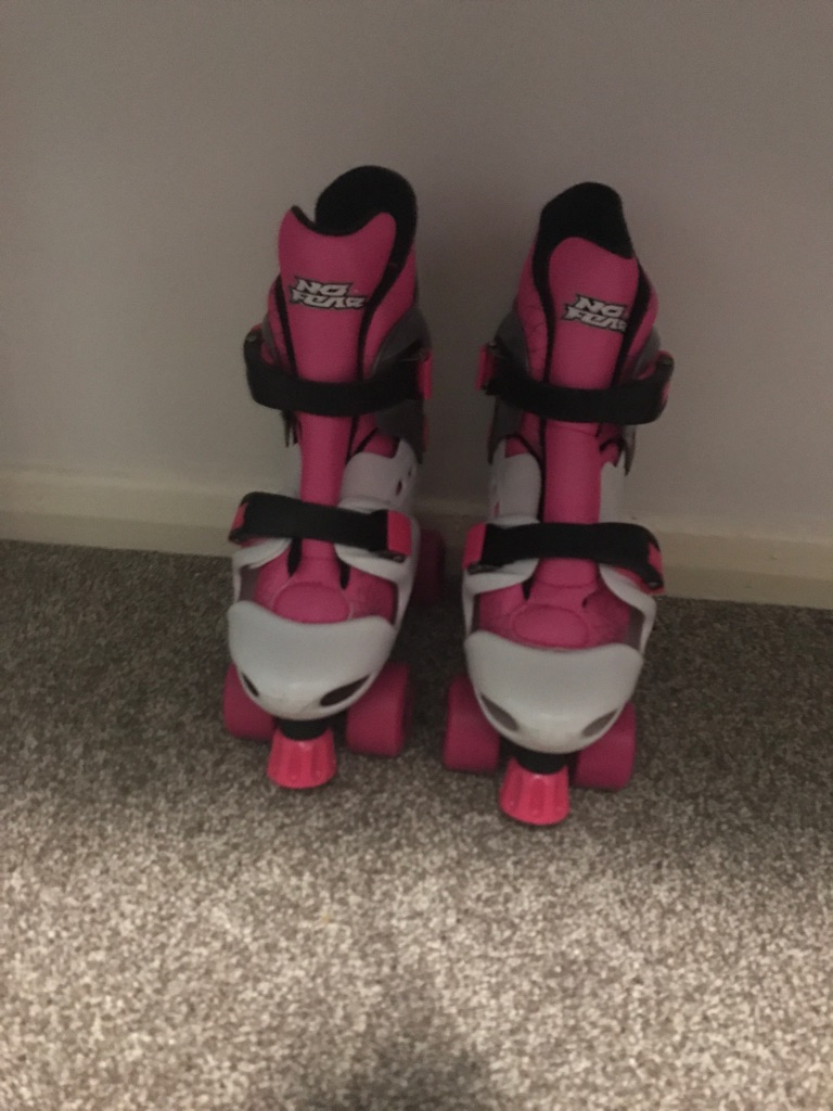 Pink,white and grey quad roller skates