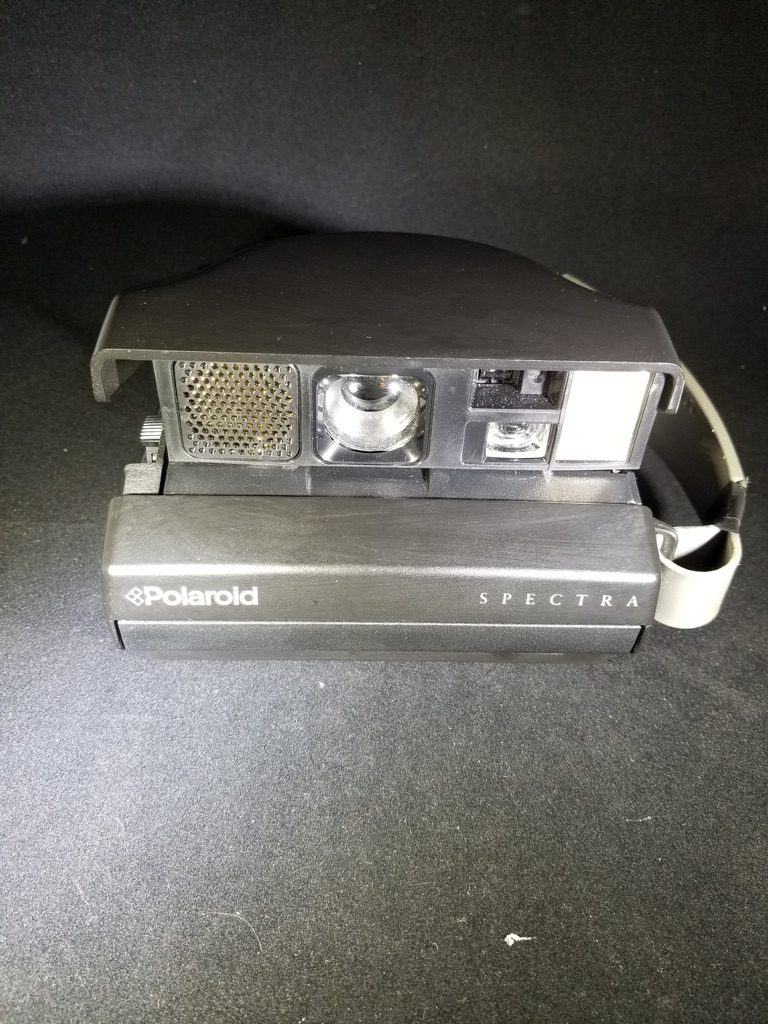 *vintage* Polaroid Spectra Camera.