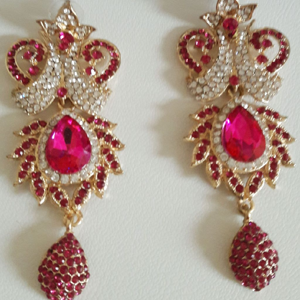 Ladies Asian style earrings NEW and Boxed