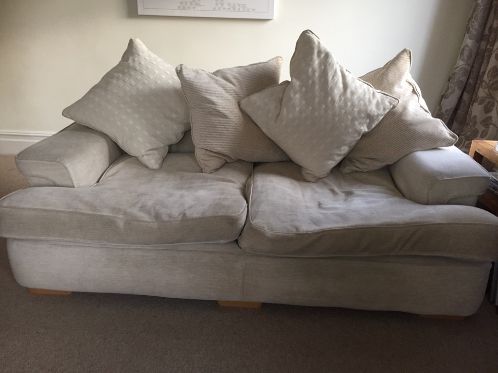 Used three seater sofa, cream.