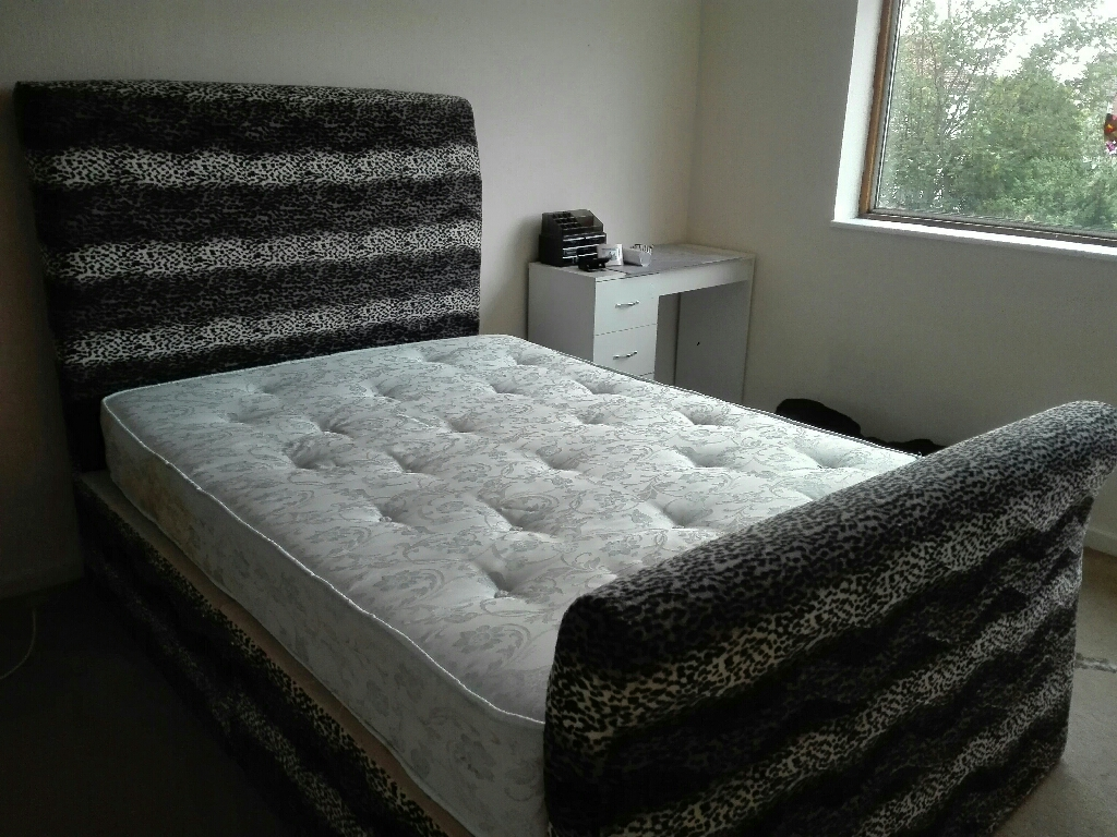 Double divan bed with.2 drawers