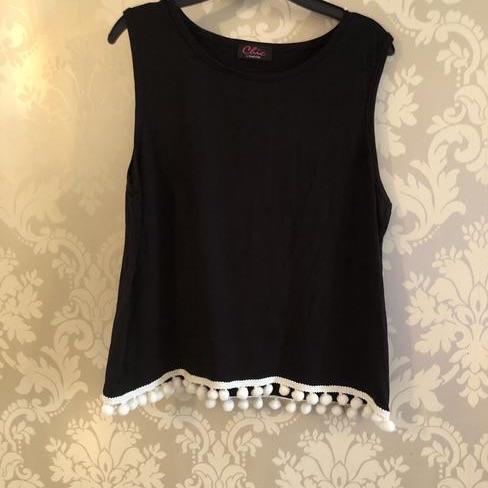 SALE NOW ON Girls black vest top with white Pom Pom hem