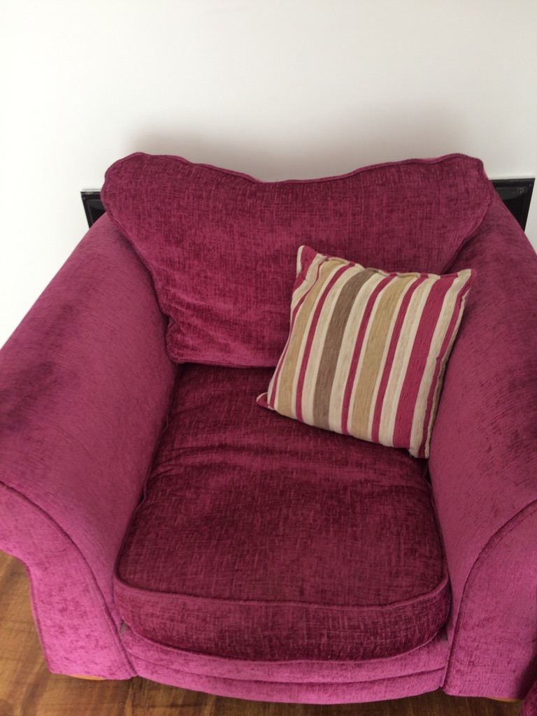 DFS pink arm chair and foot stool/storage