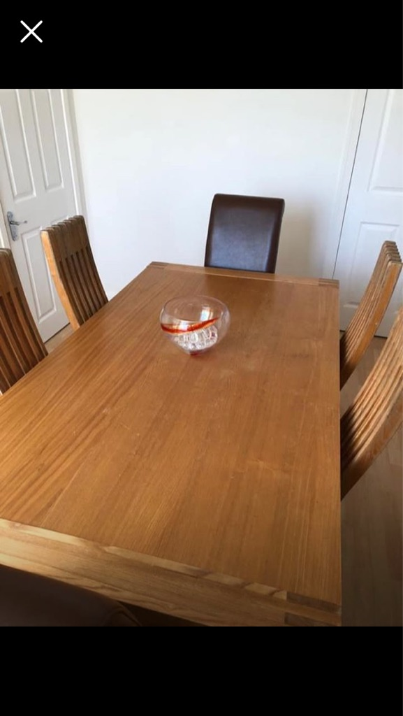 Solid oak dining table and 6 faux brown leather chairs