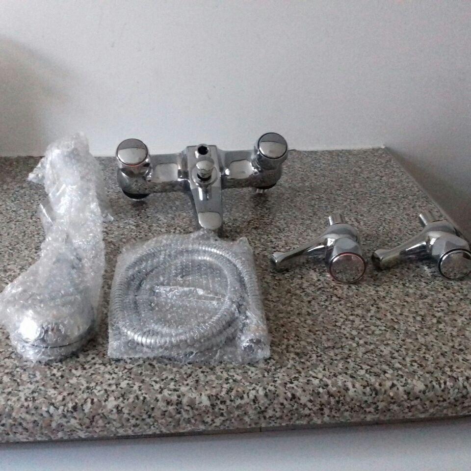 Deck mounted bath shower mixer