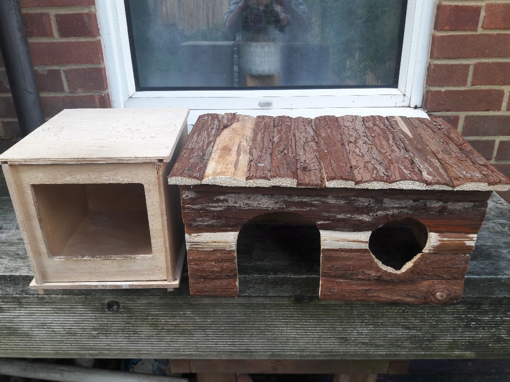 Two guinea pig hideout shelters