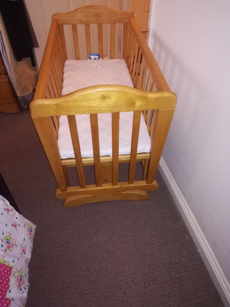 SOLD Lovely light wood gliding crib in great condition £60