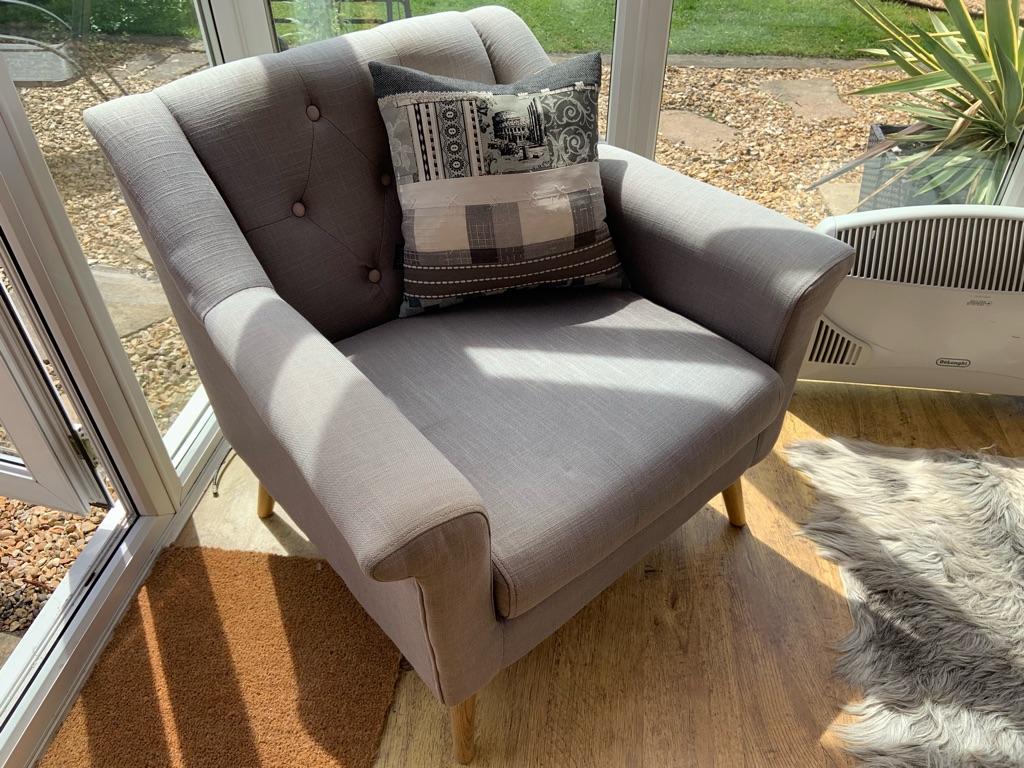 Contemporary armchair in grey fabric