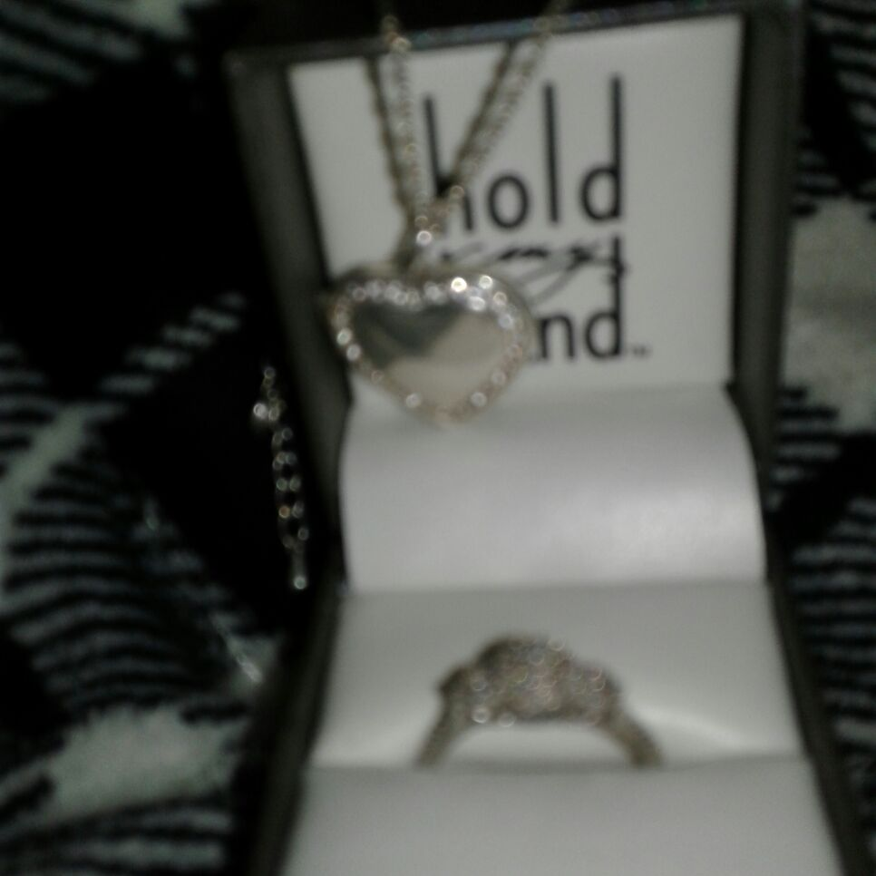 Heart shaped lock it and a promise ring