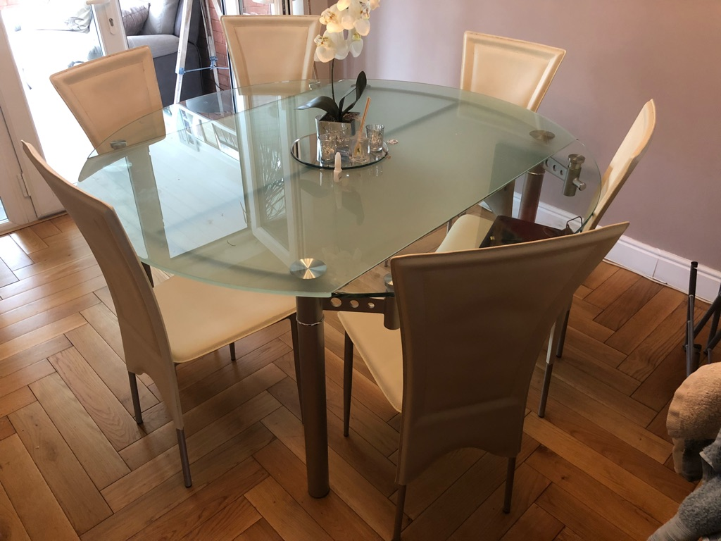 X Harvey's furniture glass dining room table & 6 cream leather chairs