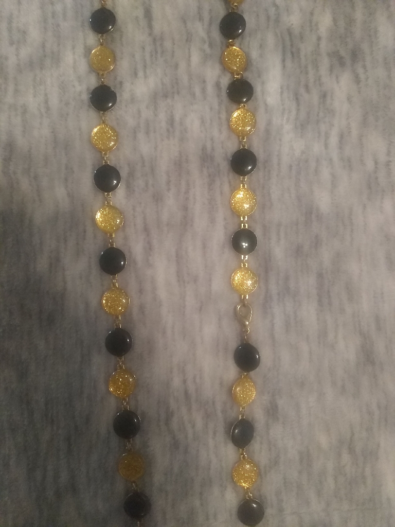 Long gold/black rounded bead necklace