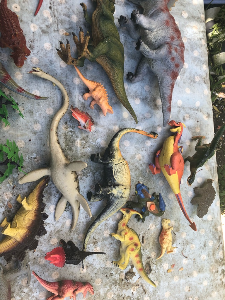 Lots of toy dinosaurs and prehistoric creatures/ animals