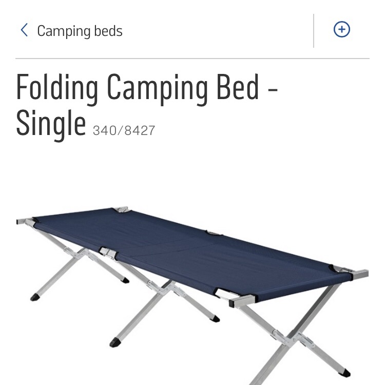 Folding blue camp bed in carry case