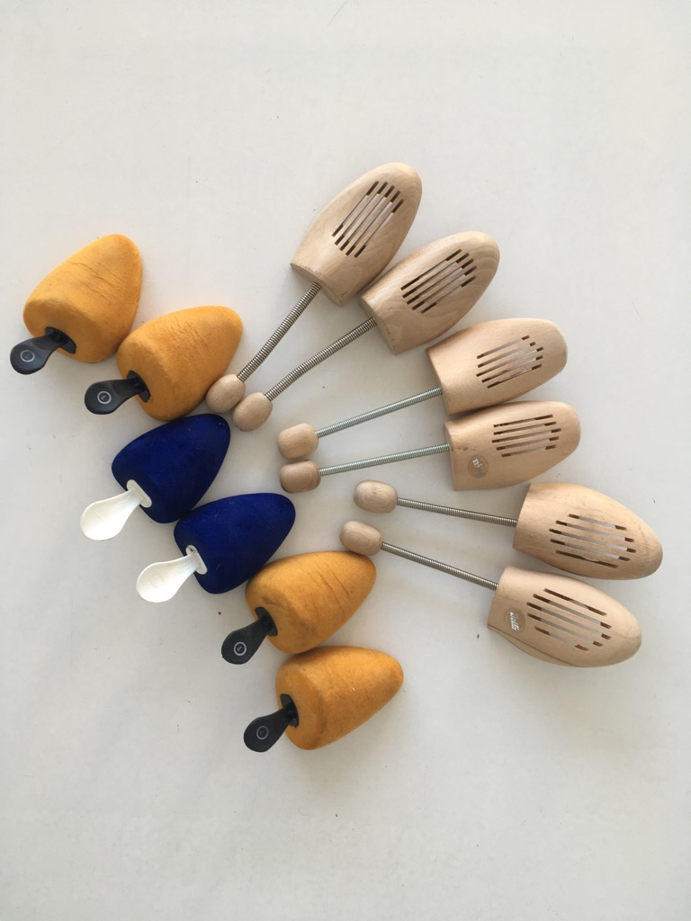 Set of wooden and velour shoe trees