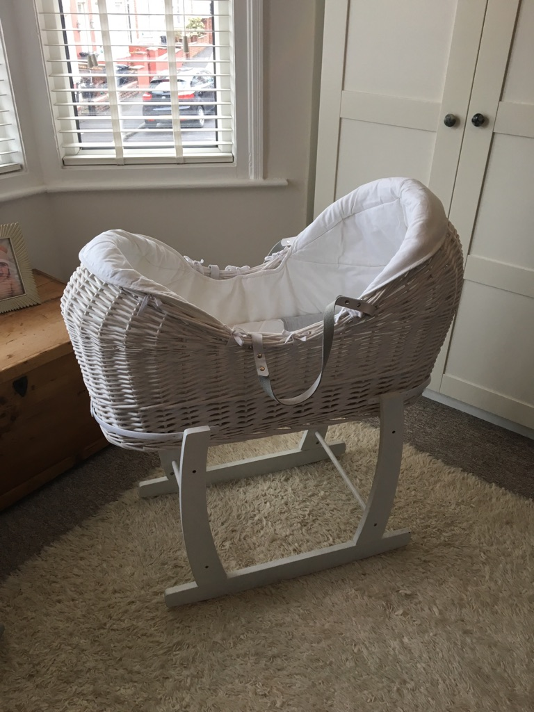 Mamas and papas Moses basket with rocking stand.