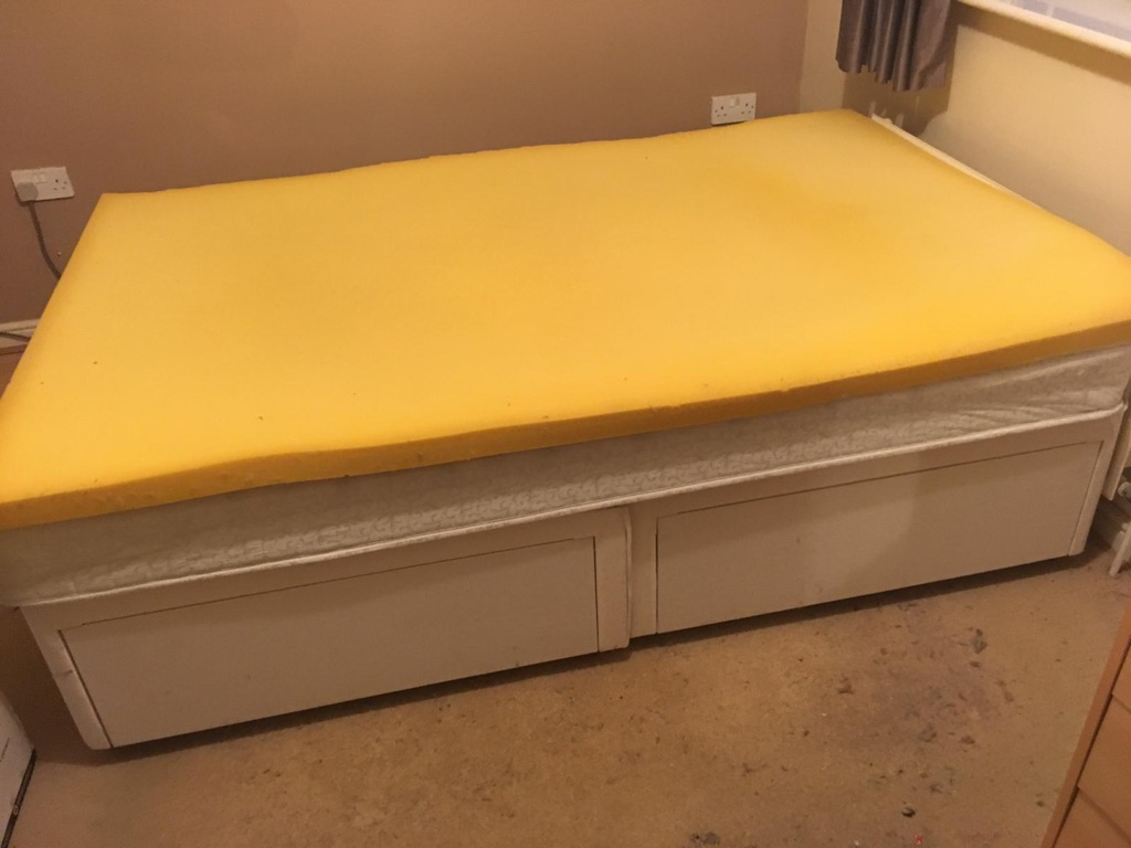 Small double bed with mattress and mattress topper