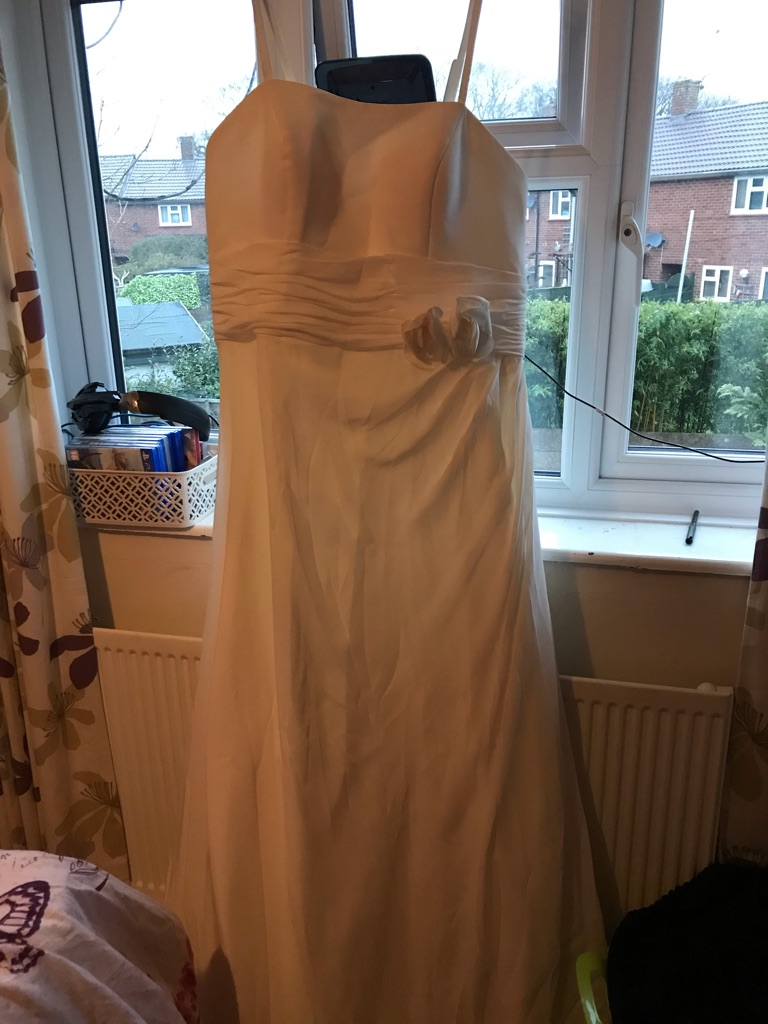 Brand new size 22 wedding dress with train and optional straps