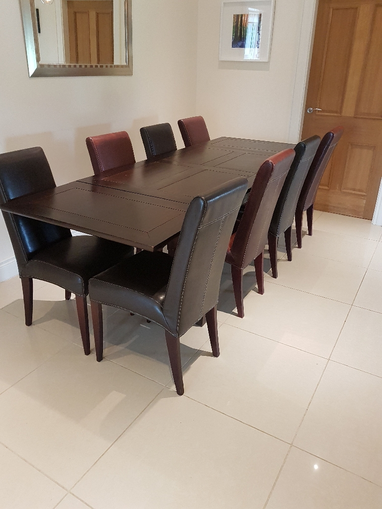Dining table with 8 faux leather chairs
