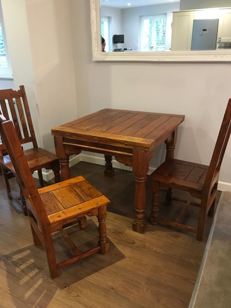 Solid oak extending table with 4 chair's