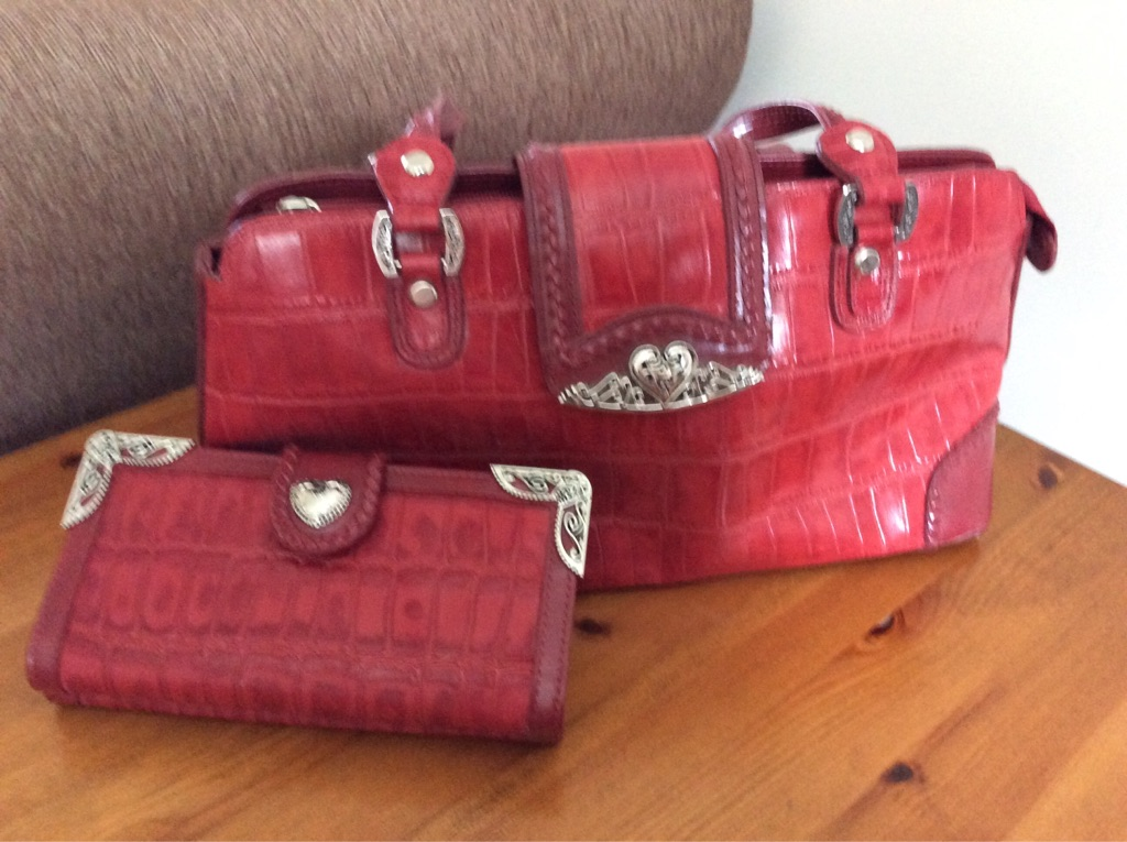 Deep red leather handbag and purse