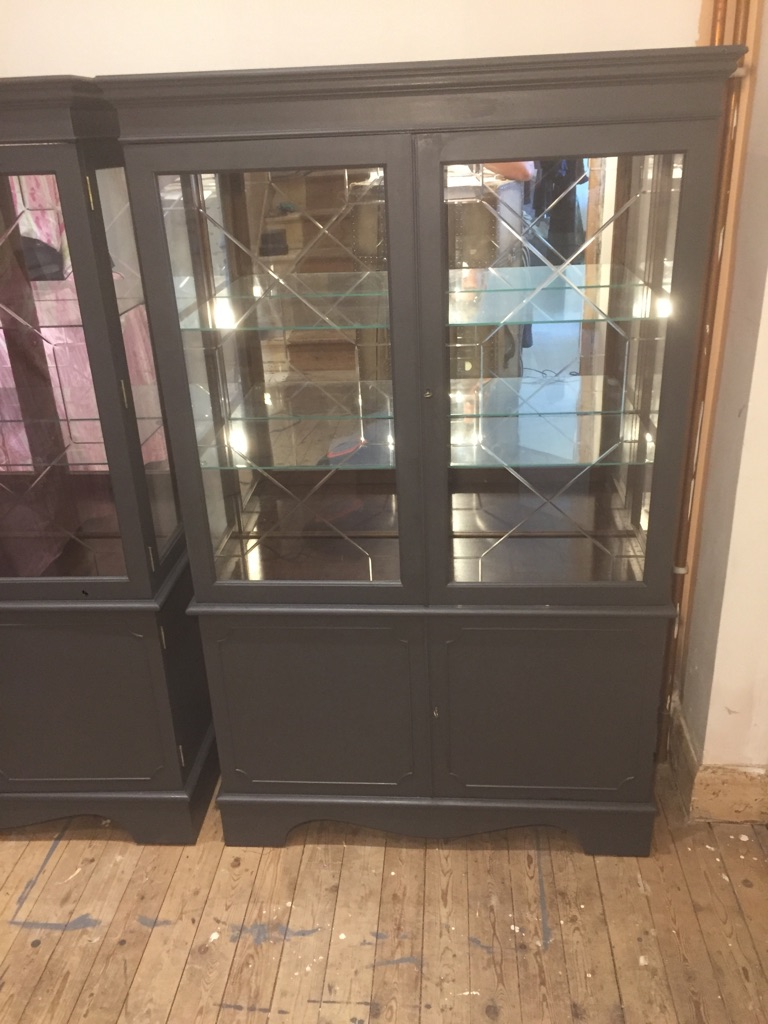 2 x dark ash display cabinets with lights. Can drop off.