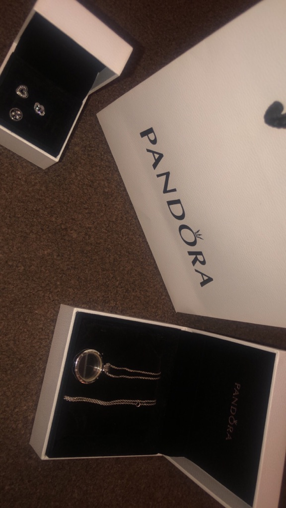 Pandora floating locket necklace with charms.