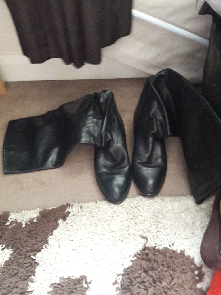 Black knee high boots size 6 made in Italy.