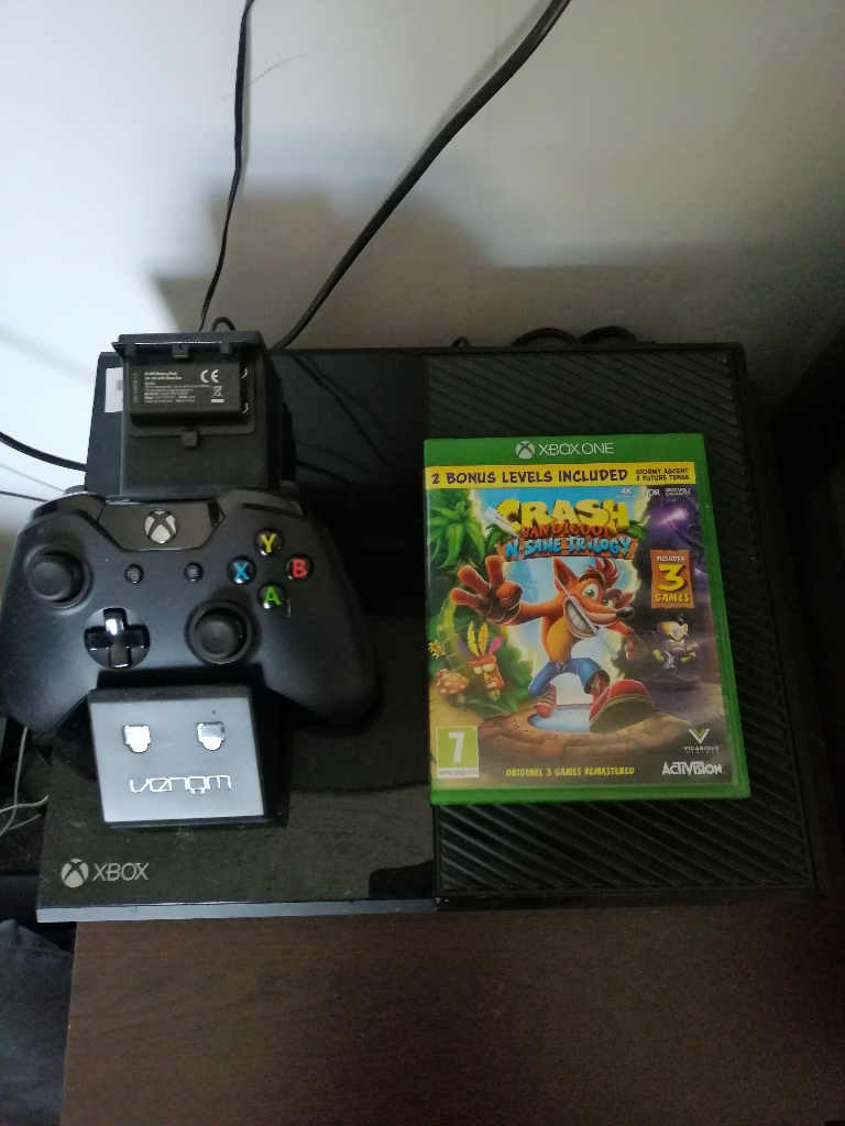 Xbox one with charging dock and game