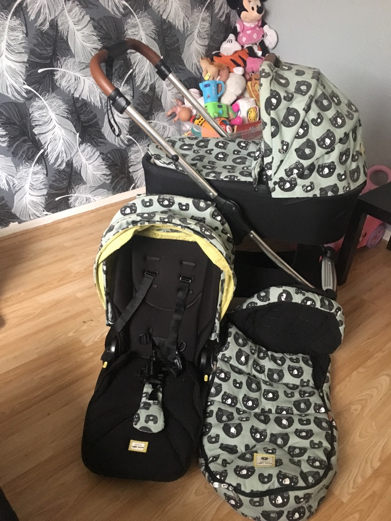 Limited edition mammas and papas Donna Wilson armadillo pram pushchair and cosy toes.