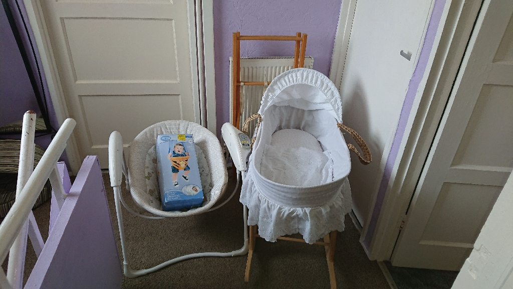 Rocking moses basket with bottom sheets, also stationery stand, swinging musical rocking seat and trigger indoor swing