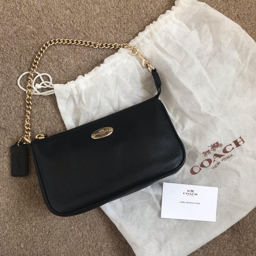 Coach Nolita leather clutch