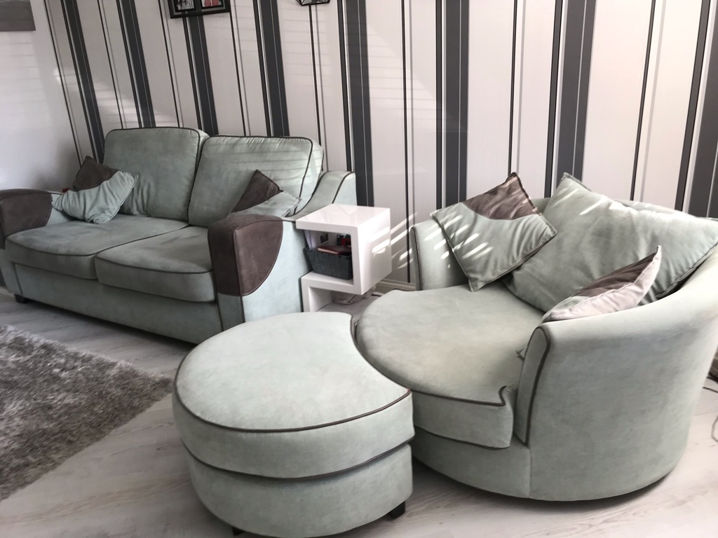 Green 3 seater couch and a cuddle chair and poufe