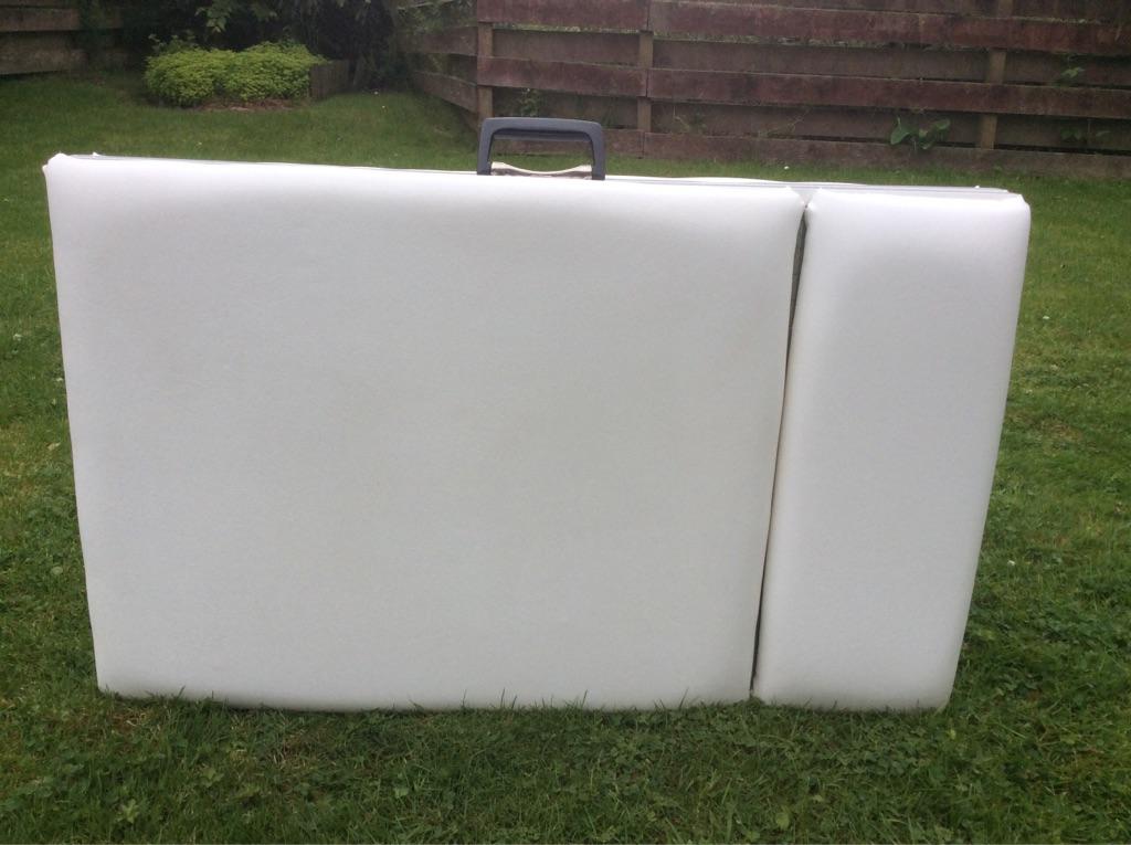 Folding, adjustable massage table