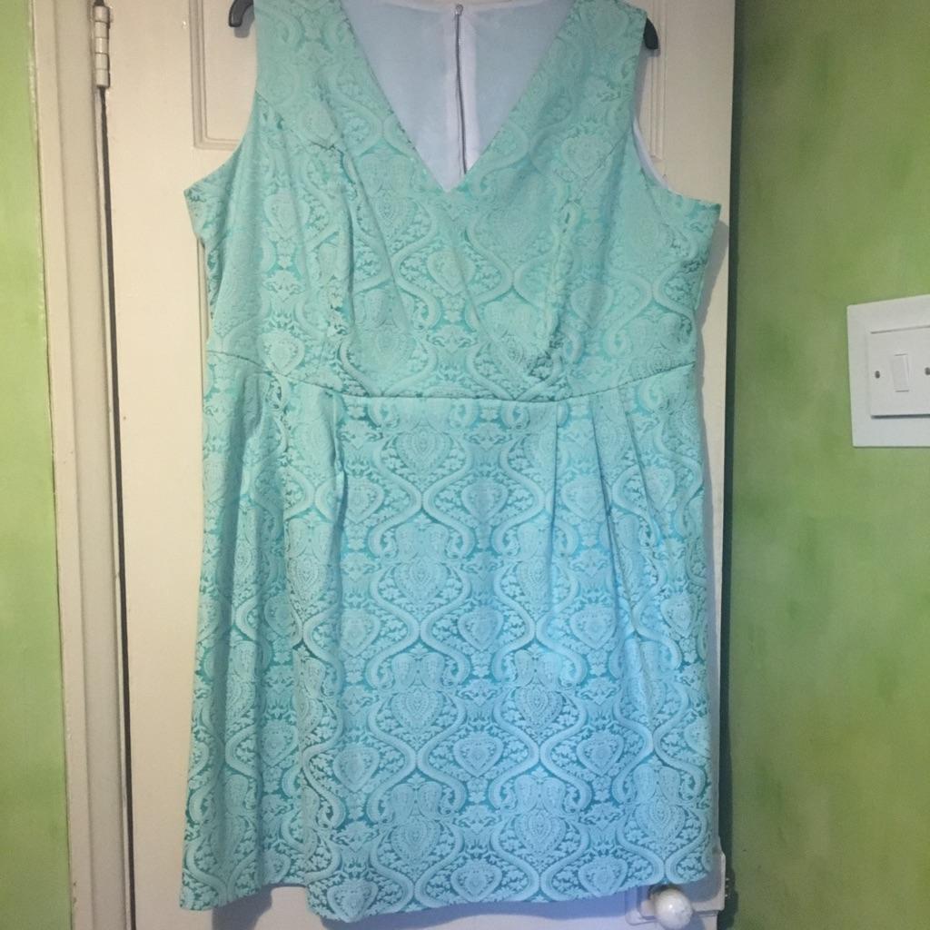Plus size mint green shimmer skater dress